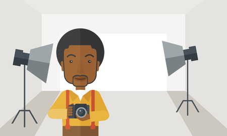 A smiling african-american photographer holding a camera and standing inside the studio with the light vector flat design illustration. Horizontal layout with a text space. Çizim
