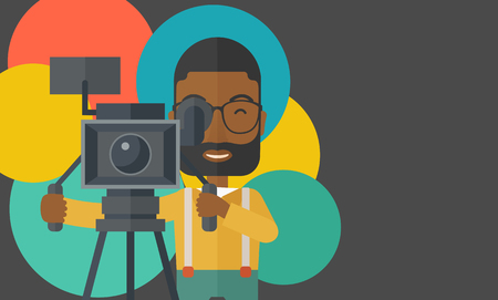 cameraman: An african-american cameraman with beard and glasses looking through movie camera on a tripod vector flat design illustration. Horizontal layout with a text space. Illustration