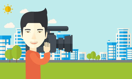 An asian cameraman with video camera taking a video with buildings around vector flat design illustration. Horizontal layout with a text space. Illustration