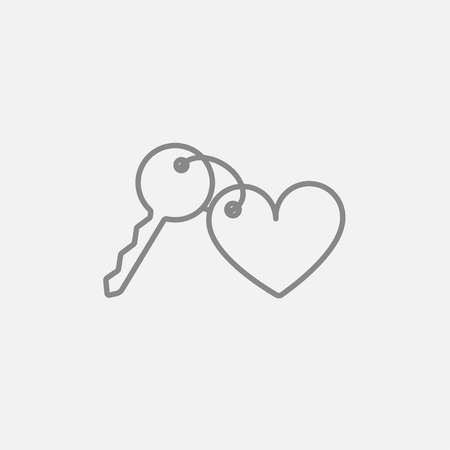 Trinket for the keys as a heart line icon for web, mobile and infographics. Vector dark grey icon isolated on light grey background.
