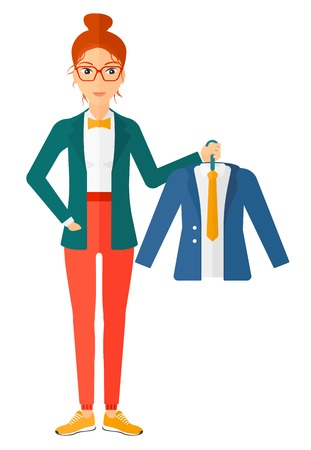 A woman holding in hand a hanger with a jacket  Ilustração