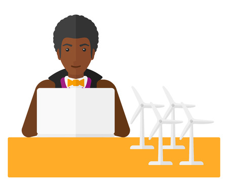 An african-american man looking at the laptop screen with wind turbine models on the table vector flat design illustration isolated on white background. Vettoriali