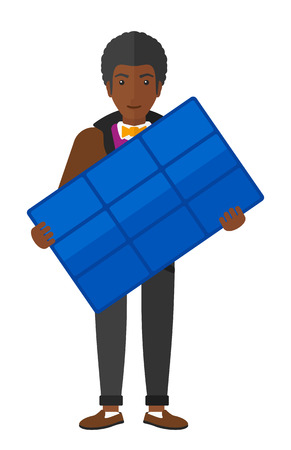 flat panel: An african-american man holding a solar panel in hands vector flat design illustration isolated on white background.