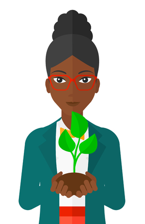 small plant: An african-american woman holding in hands a small plant in soil vector flat design illustration isolated on white background.