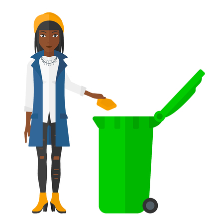 trash container: An african-american woman throwing a trash into a green bin vector flat design illustration isolated on white background.