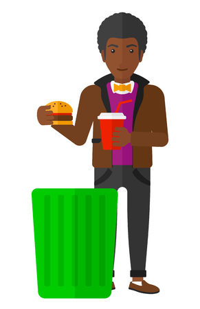 An african-american man putting junk food into a trash bin vector flat design illustration isolated on white background. Stock Illustratie