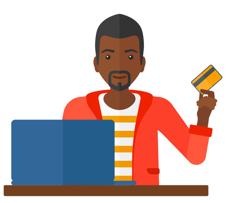 man with laptop: An african-american man sitting in front of laptop with credit card in hand and making purchases online vector flat design illustration isolated on white background.