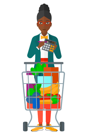 woman shopping cart: An african-american woman standing near shopping cart and a calculator in hands vector flat design illustration isolated on white background.