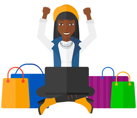 white goods: An african-american woman sitting in front of laptop with hands up and some bags of goods nearby vector flat design illustration isolated on white background. Illustration
