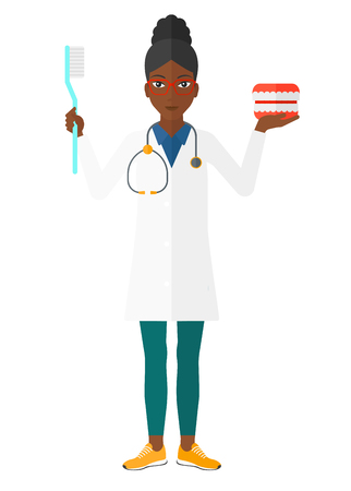 An african-american dentist with a dental jaw model and a toothbrush vector flat design illustration isolated on white background.