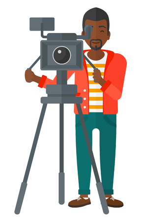 cameraman: An african-american cameraman looking through movie camera on a tripod vector flat design illustration isolated on white background.