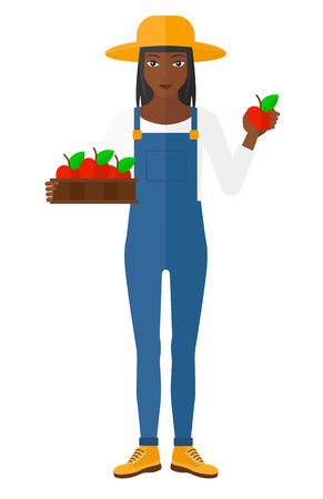 peasant woman: An african-american farmer holding a box with apples in one hand and an apple in another vector flat design illustration isolated on white background.