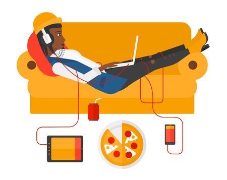 electronic devices: An african-american woman in headphones lying on a sofa with electronic devices and fast food vector flat design illustration isolated on white background.