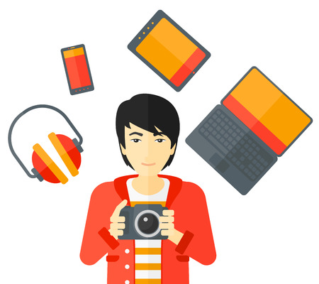 asian man laptop: An asian man holding a camera and some gadgets around him vector flat design illustration isolated on white background. Illustration