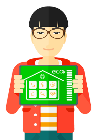 smart man: An asian man holding a tablet computer with smart home application on a screen vector flat design illustration isolated on white background.