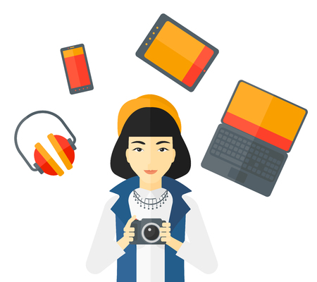 multiple ethnicities: An asian woman holding a camera and some gadgets around her vector flat design illustration isolated on white background. Illustration