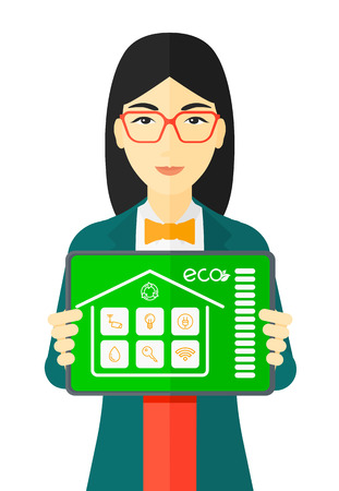 An asian woman holding a tablet computer with smart home application on a screen vector flat design illustration isolated on white background.