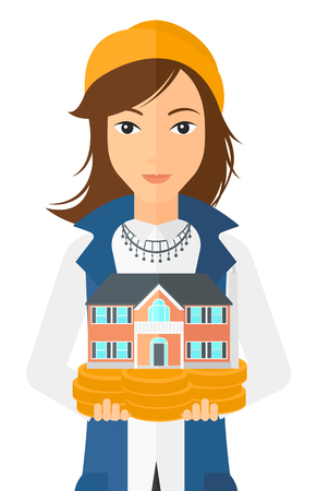 hands holding house: A woman holding model of house in hands vector flat design illustration isolated on white background. Illustration