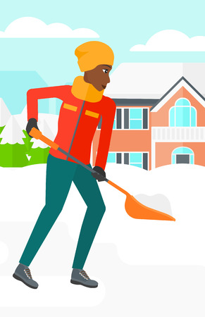 An african-american woman shoveling and removing snow in front of house  vector flat design illustration. Vertical layout. Ilustração