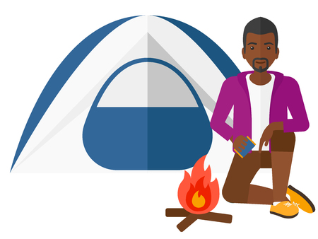 kindle: An african-american man kindling a fire in camp vector flat design illustration isolated on white background.