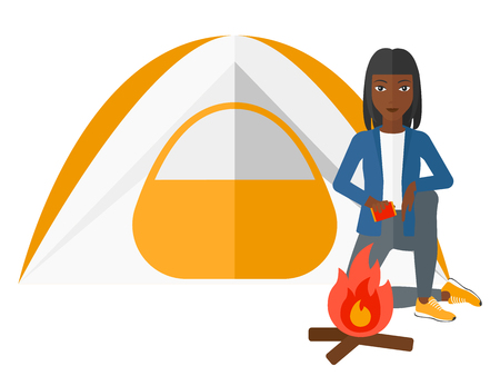 kindling: An african-american woman kindling a fire in camp vector flat design illustration isolated on white background.