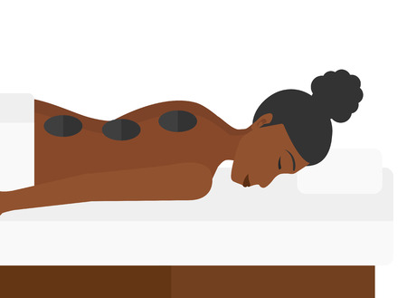 An african-american woman relaxing while getting stone therapy massage vector flat design illustration isolated on white background. Illustration