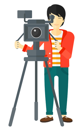 cameraman: An asian cameraman looking through movie camera on a tripod vector flat design illustration isolated on white background. Illustration