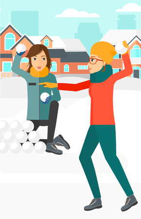 Two women playing in snowballs outdoors on city background vector flat design illustration. Vertical layout. Ilustracja