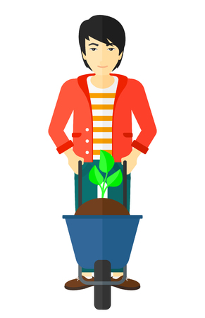 An asian man standing with a plant and soil in a wheelbarrow vector flat design illustration isolated on white background.
