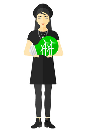 electricity generation: An asian woman holding in hands a big light bulb with small wind turbines inside vector flat design illustration isolated on white background. Illustration