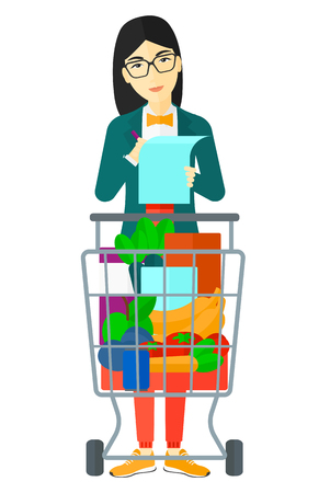 An asian thoughtful woman standing with full supermarket trolley and holding a shopping list in hands vector flat design illustration isolated on white background. Illustration