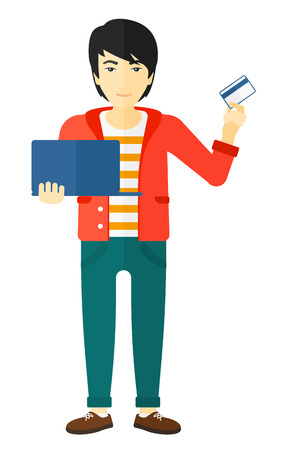 man holding card: An asian man holding a laptop and a credit card in hands and making purchases online vector flat design illustration isolated on white background.