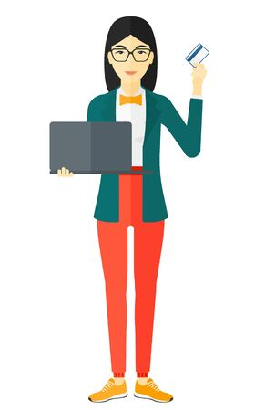 An asian woman holding a laptop and a credit card in hands and making purchases online vector flat design illustration isolated on white background.