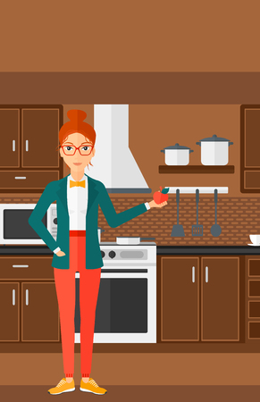 woman eating fruit: A woman standing in the kitchen and holding an apple in hand vector flat design illustration. Vertical layout.