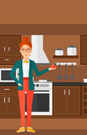 kitchen cartoon: Una mujer de pie en la cocina y la celebraci�n de una manzana en la mano ilustraci�n vectorial dise�o plano. disposici�n vertical.