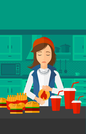 reflux: A woman standing in the kitchen in front of table full of junk food and suffering from heartburn vector flat design illustration. Vertical layout.