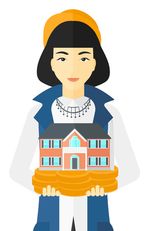 hands holding house: An asian woman holding model of house in hands vector flat design illustration isolated on white background.