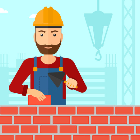 mason: A hipster bricklayer with a spatula and a brick in hands on a background of construction site vector flat design illustration. Square layout.
