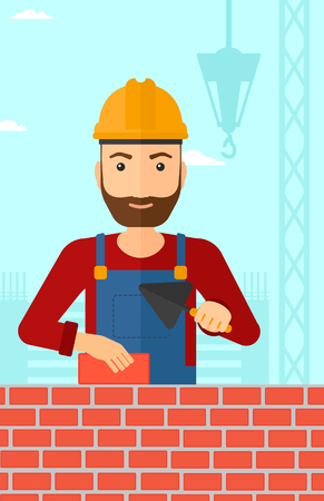 laborer: A hipster bricklayer with a spatula and a brick in hands on a background of construction site vector flat design illustration. Vertical layout.
