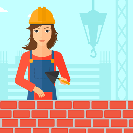 A female bricklayer with a spatula and a brick in hands on a background of construction site vector flat design illustration. Square layout.