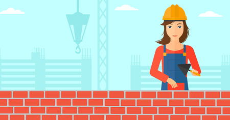 mason: A female bricklayer with a spatula and a brick in hands on a background of construction site vector flat design illustration. Horizontal layout. Illustration