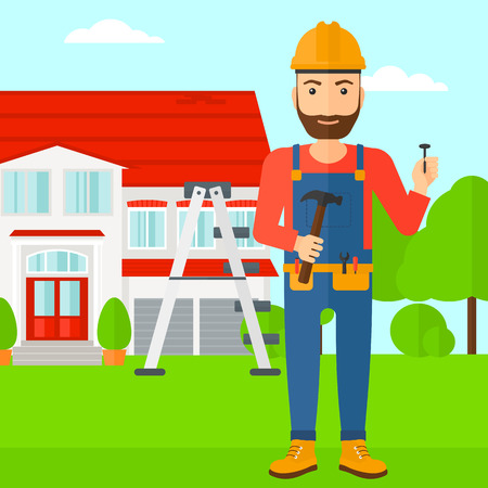 cartoon carpenter: A hipster man in helmet with a hummer and a nail in hands standing on a house background vector flat design illustration. Square layout.