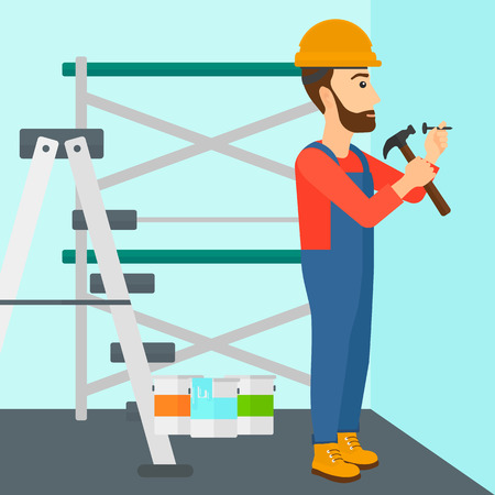 A hipster man with the beard hitting a nail in the wall with a hummer on a background of room with paint cans and ladder vector flat design illustration. Square layout.