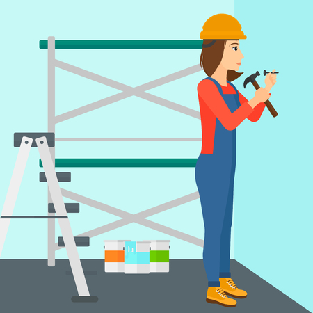 A woman hitting a nail in the wall with a hummer on a background of room with paint cans and ladder vector flat design illustration. Square layout. Иллюстрация