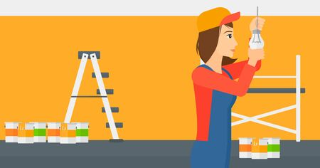 screwing: A female worker twisting a light bulb on a background of room with paint cans and ladder vector flat design illustration isolated on white background. Horizontal layout. Illustration