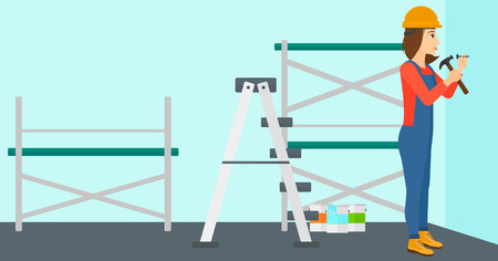 A woman hitting a nail in the wall with a hummer on a background of room with paint cans and ladder vector flat design illustration. Horizontal layout. Иллюстрация