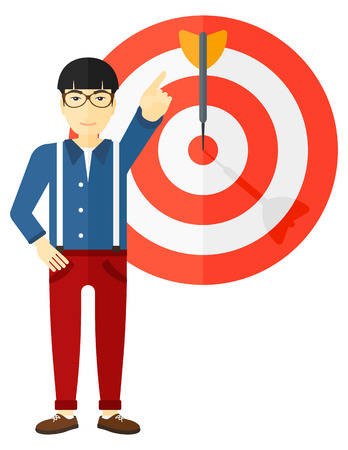An asian businessman standing and pointing at arrow in a target board vector flat design illustration isolated on white background.