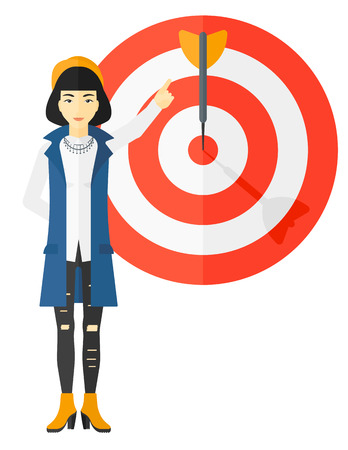 An asian business woman standing and pointing at arrow in a target board vector flat design illustration isolated on white background. Vettoriali