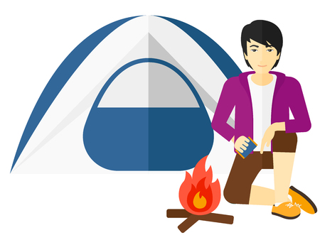 kindling: An asian man kindling a fire in camp vector flat design illustration isolated on white background.