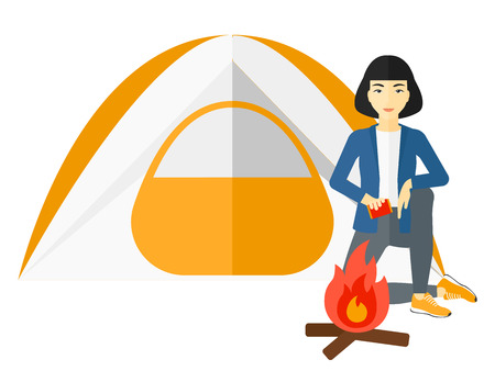 An asian woman kindling a fire in camp vector flat design illustration isolated on white background.